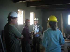 Part of the crew in the living area of the tower where the carpentry shop was set up.